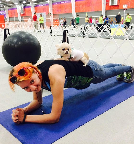 Dog and girl working out