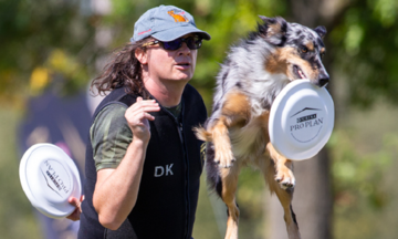 Woman and dog competing in freestyle disc event
