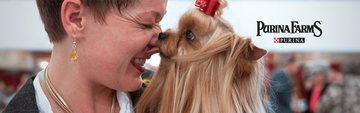 Woman smiling nose to nose with her small dog