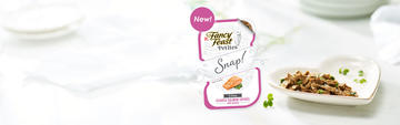 fancy feast petites cat food package next to a plate of the food