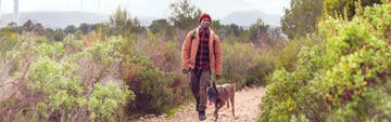 Man walking dog fresh quality outdoors in the US wilderness